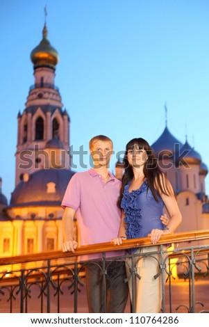 husband wife hug near Alexander Nevsky church in Vologda, Russia, long exposure - stock photo
