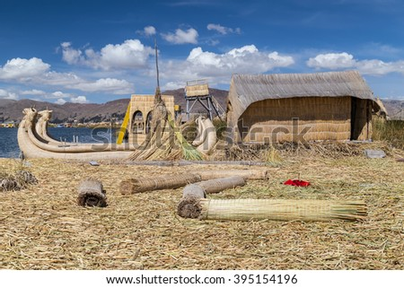 Hut and canoe boat at Uros floating island and village on Lake Titicaca near Puno, Peru - stock photo