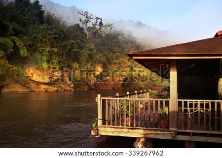 Hut near river and mountain in Thailand at morning - stock photo
