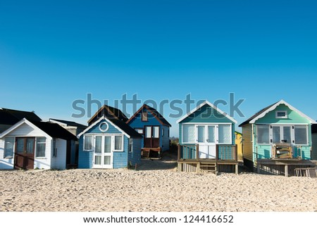 Huts at Hengistbury Head near Christchurch in Dorset. England - stock photo
