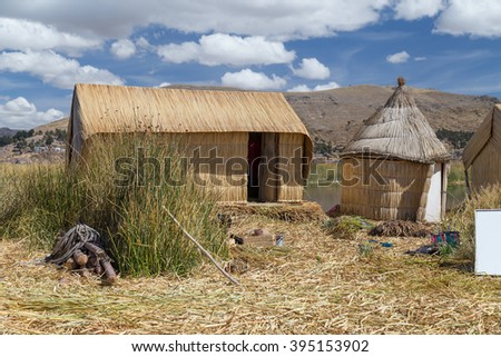 Huts at Uros floating island and village on Lake Titicaca near Puno, Peru - stock photo