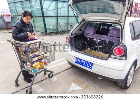 HUZHOU,CHINA - FEB 17: Supermarket shopping people on February 17th 2015 in Huzhou.The next day is the Chinese Lunar New Year,People prepare New Year. - stock photo
