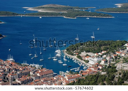 Hvar and its harbor and Hells islands - stock photo