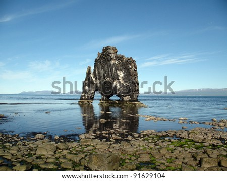 Hvitserkur: is it a troll turned to stone... or just a thirsty amazing dragon? - stock photo