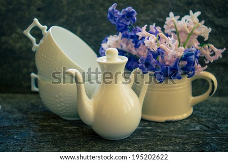 Hyacinth in an old clay vase with waterdrops and on a old piece of wood for a rustic look.