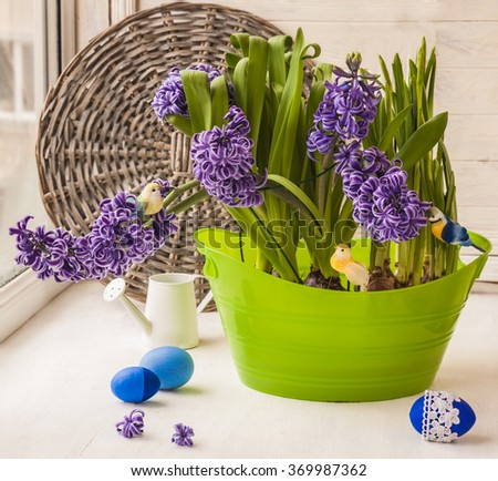 Hyacinths and daffodils on the window next to Easter eggs