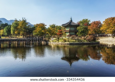 Hyangwonjeong autumn fall reflections in seoul, south korea. Fall foliage reflecting on the lake surrounding the pavilion. The pavilion is lcoated in gyeongbokgung in seoul, south korea.  - stock photo