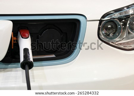 hybrid car is charging new technology - stock photo