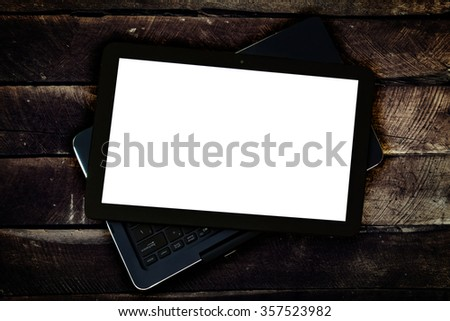 Hybrid device(laptop and tablet) on a wood background. - stock photo