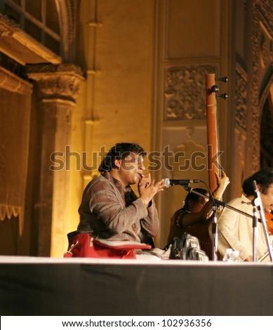 HYDERABAD,AP,INDIA-APRIL 20:Guinnes world record holder Vidwan Ghantasala Satya Sai  performs Morsing during Heritage week celebrations at Chowmahalla Palace,on April 20,2012 in Hyderabad,Ap,India. - stock photo