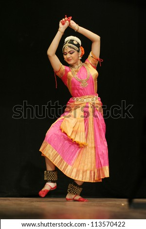HYDERABAD,AP,INDIA-JUNE 05:Eshita Jayaswal performs Bharatanatyam dance at ravindra bharati on June 05,2012 in Hyderabad,Ap,India. A popular classical dance form of Tamil Nadu,India.
