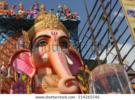 HYDERABAD,AP,INDIA- SEPTEMBER 28:People pray to 58 feet high Lord Ganesh idol, at Khairatabad, during  Hindu festival with 3500 kg laddu as offering  on September 28,2012 in Hyderabad,India. - stock photo