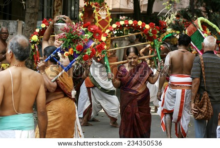 HYDERABAD,INDIA-APRIL 13:Hindu devotees take procession of lord Subramanya swamy  through the streets with murugan kavadi in Hyderabad,India on April 13,2014.