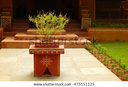 HYDERABAD,INDIA-AUGUST 28: tulasi kota a small podium like arrangement with holy plant in front of Hindu house on August 28,2016 in Hyderabad,India