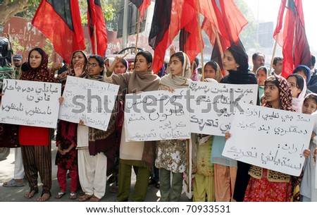 HYDERABAD, PAKISTAN - FEB 10: Activists of Sindhyani Tehreek chant slogans against Karo-Kari and in favor of their demands during protest demonstration on February 10, 2011 in Hyderabad. - stock photo