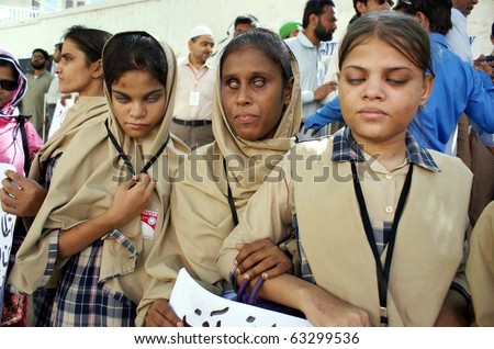 "HYDERABAD, PAKISTAN - OCT 15: Blind people are protesting in favor of their demands during demonstration, on occasion of the ""World White Cane Safety Day"" on October 15, 2010 in Hyderabad. - stock photo"