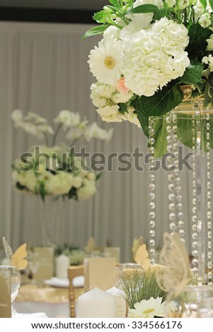 Hydrangea, roses and orchid bouquet. White and gold wedding table flower decoration. Glamorous Event, celebration. Crystal wedding table decor  - stock photo