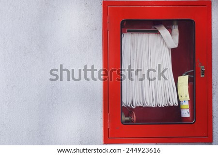 Hydrant with water hoses and fire extinguish equipment, Fire fighter equipment in the red box - stock photo