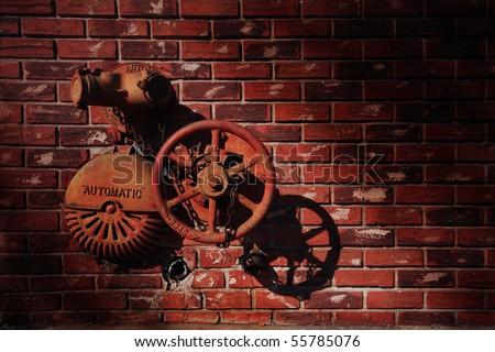 Hydrants on the Red brick wall, Miami , Florida, USA. - stock photo
