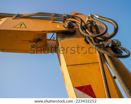 Hydraulic connections hoses of a machinery industrial detail. Excavator arm - stock photo