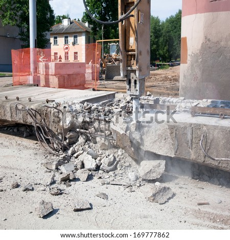 Hydraulic Crushing Hammer during demolishing works - stock photo