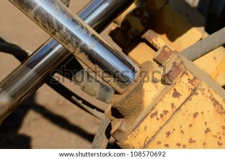 Hydraulic detail of a construction tractor at a large construction site