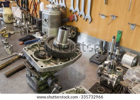 hydraulic engine parts  on the work table - stock photo