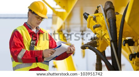 Hydraulic engineer doing a safety check on a new installation - stock photo