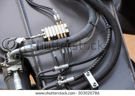 Hydraulic hoses to a construction equipment / Hydraulic hoses - stock photo