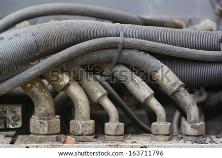 Hydraulic Hoses with Connectors on Paving Equipment as Design Element  - stock photo