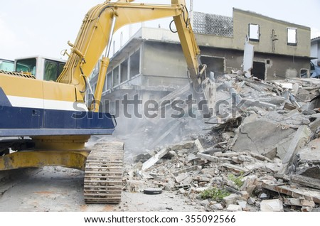 Hydraulic jackhammer excavator backoe machinery working on site demolition - stock photo