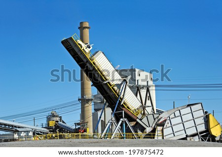 Hydraulic Lift Dumping a Truck Load of Wood Chips at Paper Mill - stock photo