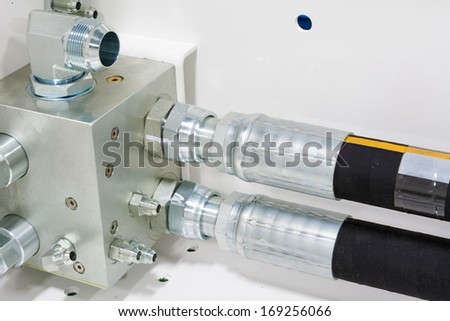 Hydraulic Manifold with Hoses and Fittings on Hydraulic Equipment - stock photo