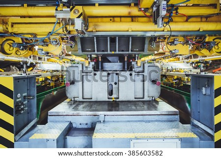 hydraulic press on car manufacture - stock photo