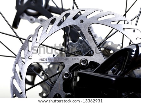 Hydraulic Rear Brakes on Bicycle - Rotor in Focus - stock photo
