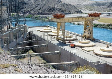 Hydroelectric generating station at Davis Dam on the Colorado River with transformers, penstock and exterior of five generators.