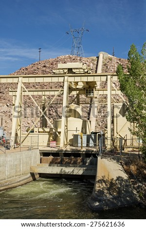 hydroelectric power plant generator with penstock and tailrace - stock photo