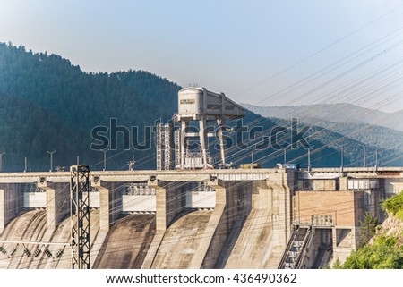Hydroelectric power station on the Yenisei River in Siberia in the glow of the sunrise