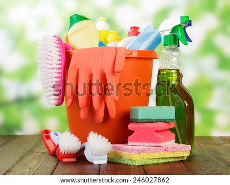 Hygiene cleanser in bottles with brush and gloves with sponge - stock photo