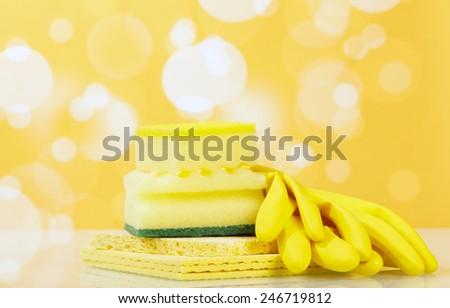 Hygiene kitchen sponge with yellow gloves - stock photo