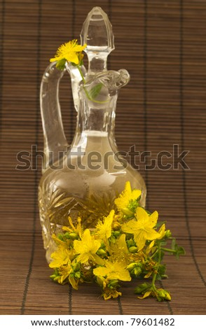 Hypericum oil with flowers - stock photo