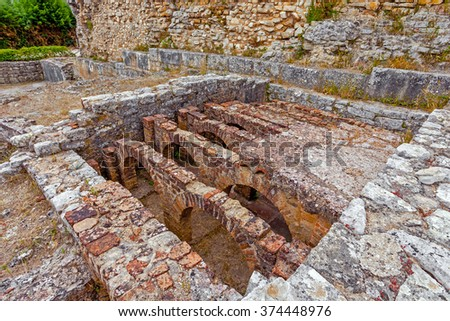 Hypocaust structure used to heat the water of the Caldarium room in the Roman Baths of the Wall. Conimbriga in Portugal, is one of the best preserved Roman cities on the west of the empire.  - stock photo