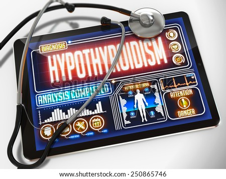 Hypothyroidism - Diagnosis on the Display of Medical Tablet and a Black Stethoscope on White Background. - stock photo
