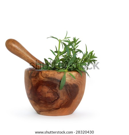 Hyssop herb leaves in an olive wood mortar with pestle over white background.