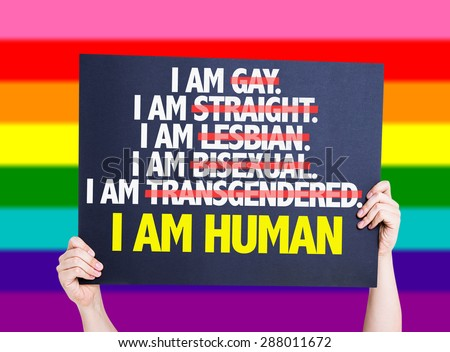 I am Gay/Straight/Lesbian/Bisexual/Trans I am Human card with rainbow background - stock photo