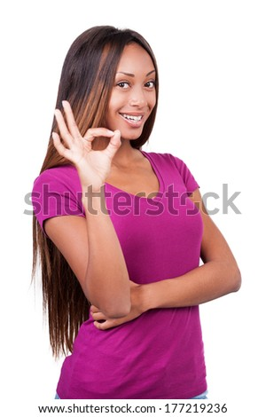 I am OK! Happy young African woman showing her hands with thumbs up while standing isolated on white  - stock photo