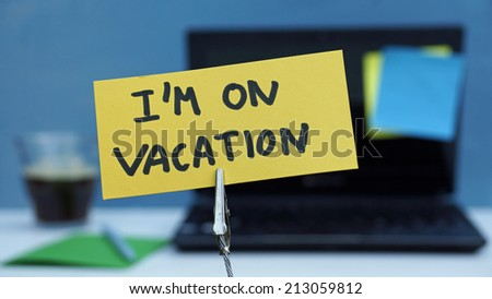 I am on vacation written on a memo at the office - stock photo