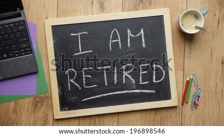 I am retired written on a chalkboard at the office - stock photo