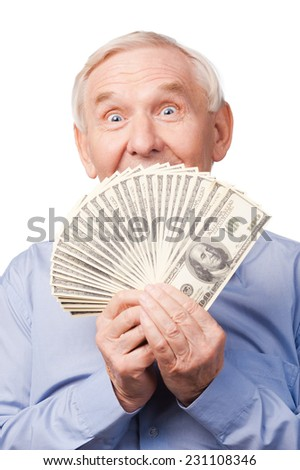 I am rich! Portrait of happy senior man covering his mouth by money and looking at camera and while standing against white background  - stock photo