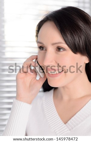I am so glad to hear you! Portrait of beautiful middle-aged woman talking at phone